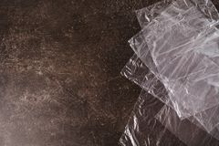 Cellophane bags on a dark marble background. Polute the nature. Eco concept Stock Photography