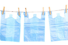 Cellophane bags hanging on rope Royalty Free Stock Images