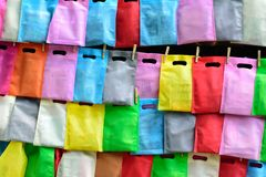 Cellophane bags hanging with rope on wall. royalty free stock photo