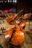 Cellos and Double bass lying on the floor Stock Images