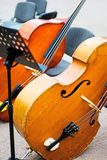Cellos at public concert Royalty Free Stock Photography