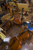 Cellos supported in chairs before the concert Stock Photos