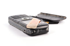 Cellphone. Old damaged cellphone  parts on isolated background Royalty Free Stock Photo