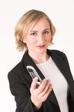 Cellphone #11. Business woman handing cellphoe to you Royalty Free Stock Image