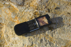 Cellphone. Cellp hone on the rock Stock Images