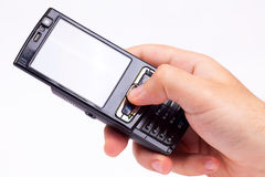 Cellphone. Hand with a cellphone on white Royalty Free Stock Photo