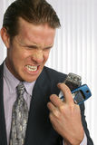 Cellphone. Angry man in suit with smashed cellphone in hand Stock Photo