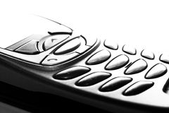 Cellphone. Shape of a cellphone burned out, white background Stock Photos