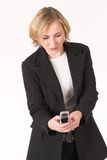 Cellphone #3. Business woman busy with cell phone Stock Photos