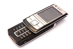 Cellphone. A black and silver modern open mobile phone. Image isolated on white studio background Stock Photos