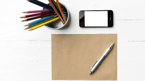 Cellphone with brown paper and pen Royalty Free Stock Photos