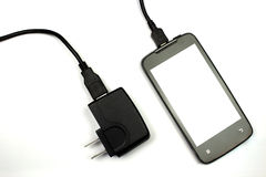 Cellphone and charger on white background Stock Photography