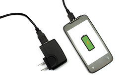 Cellphone and charger on white background, isolated Royalty Free Stock Photos