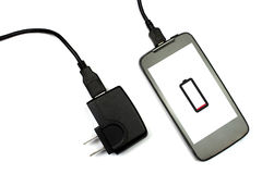 Cellphone and charger on white background, isolated Royalty Free Stock Photography