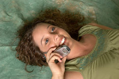 Cellphone Chatting. An attractive young lady talking on a cellphone Royalty Free Stock Images
