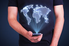 Cellphone with digital world map Royalty Free Stock Photography