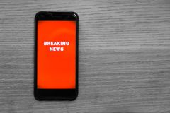 Cellphone Breaking News Alert Royalty Free Stock Photography