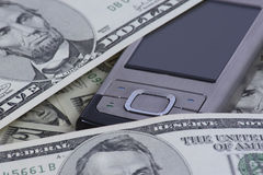 Cellphone with dollars Royalty Free Stock Photos