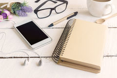 Cellphone and earphone with a cup of coffee Royalty Free Stock Photos