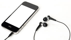 Cellphone with earphone Stock Image