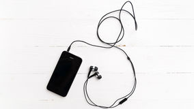 Cellphone with earphone Royalty Free Stock Image