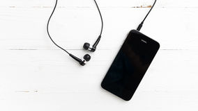 Cellphone with earphone Stock Photography