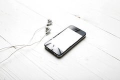 Cellphone with earphone Stock Photos