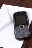 Cellphone and envelope Stock Photography