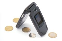 Cellphone with euro and coins Stock Photos