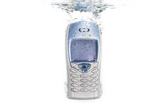 A cellphone falling in water Royalty Free Stock Photography