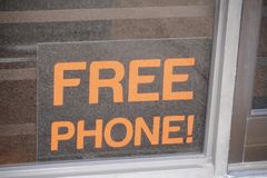 Cellphone for free with Service. An Authorized Dealer of cell phone service and cell phone distribution services business offers customers a free wireless cell Royalty Free Stock Photos