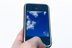 Cellphone in hand royalty free stock photography