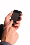Cellphone in hands. On white Royalty Free Stock Image