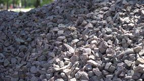 Cellphone in heap of pebble. Unbreackable touchscreen of mobile phone, gorillaglass stock video footage
