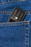Cellphone in jeans stock foto's