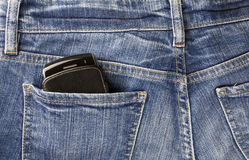 Cellphone and jeans Royalty Free Stock Images