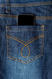 Cellphone in jeans pocket Royalty Free Stock Image