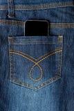 Cellphone in jeans pocket. Mobile phone in denim jeans back pocket royalty free stock image