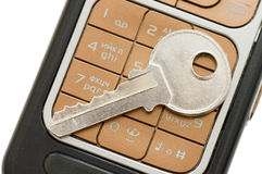 Cellphone and key  close up Royalty Free Stock Images