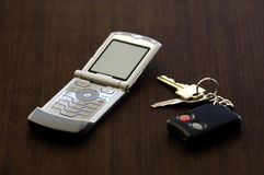 Cellphone and keys. A picture of a motorola cellphone and keys on a wood surface Stock Photography