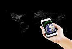 Cellphone or mobile with text information and earth with hand on. Black background Stock Images