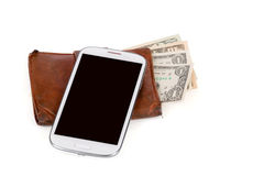 Cellphone and money on white Stock Photos