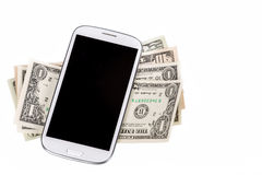 Cellphone and money on white Royalty Free Stock Image