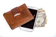 Cellphone and money on white Stock Images