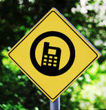 Cellphone pictogram. Yellow traffic label with cellphone pictogram Royalty Free Stock Images