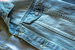 Cellphone in a pocket of jeans jacket royalty free stock photo