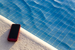 Cellphone By The Pool Stock Photography
