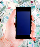 Cellphone and Russian Rubles Stock Images