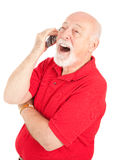 Cellphone Senior - Laughing. Senior man talking on his cellphone laughs out loud.  Isolated on white Stock Photo