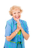 Cellphone Senior Woman - Ecstatic. Ecstatic senior woman gets good news by phone, over her hands free set. Isolated on white royalty free stock photo